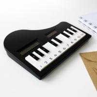 Grand Piano shaped Calculator